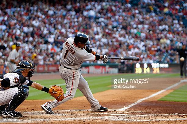 Bengie Molina of the San Francisco Giants hits the ball against the Houston Astros on Opening Day at Minute Maid Park on April 5 2010 in Houston...