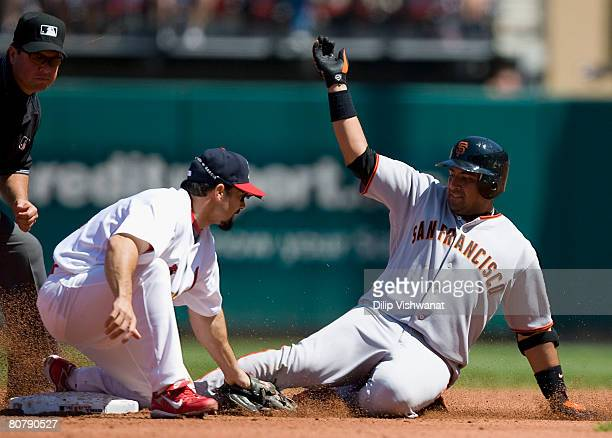 Bengie Molina of the San Francisco Giants is tagged out at second base against Aaron Miles of the St. Louis Cardinals as umpire Sam Holbrook...