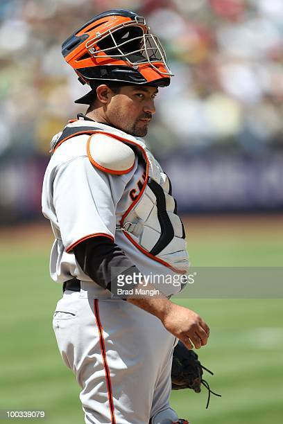 Bengie Molina of the San Francisco Giants takes a break behind the plate against the Oakland Athletics during the game at the OaklandAlameda County...