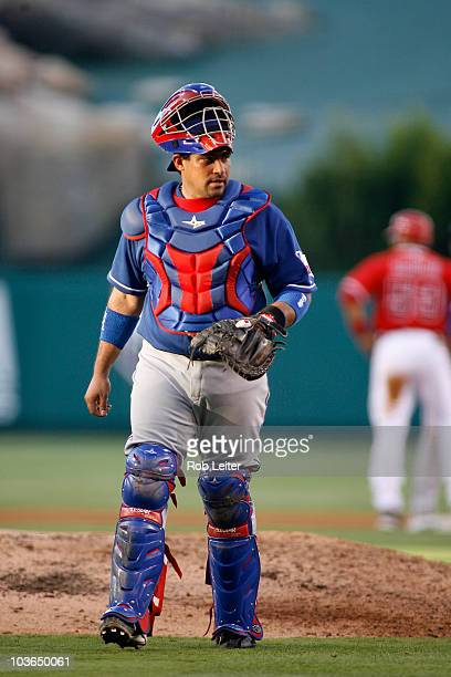 Bengie Molina of the Texas Rangers catches during the game against the Los Angeles Angels of Anaheim at Angel Stadium on July 31 2010 in Anaheim...