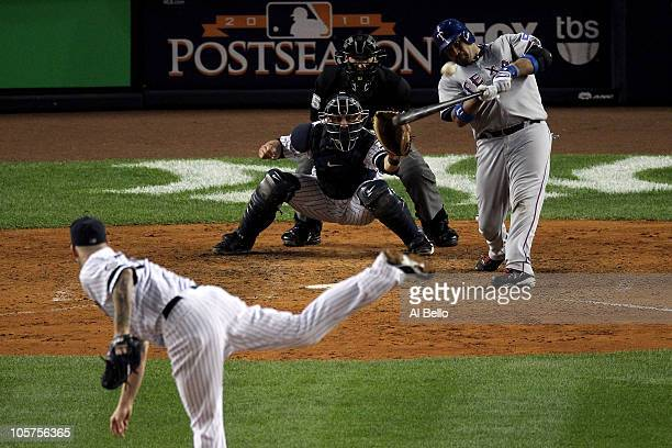 Bengie Molina of the Texas Rangers hits a 3run home run in the top of the second inning against AJ Burnett of the New York Yankees in Game Four of...