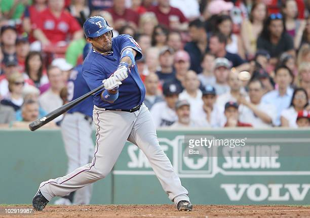Bengie Molina of the Texas Rangers hits a two run homer in the first inning against the Boston Red Sox on July 15 2010 at Fenway Park in Boston...