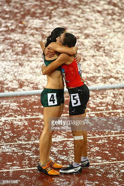 Benhama Sanaa of Morocco celebrates with Hayes Llse of South Africa after the Women's 100m T13 Final Athletics event at the National Stadium during...