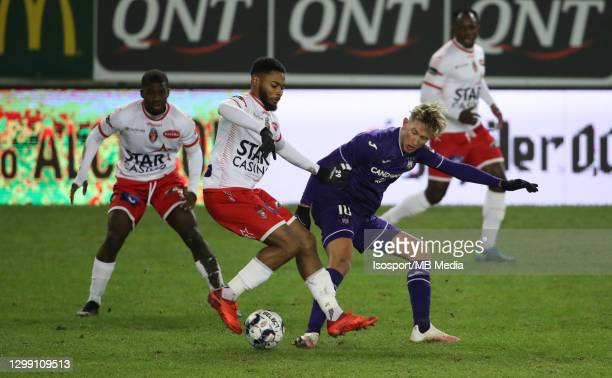 Beni Badibanga of Mouscron battles for the ball with Michel Vlap of Anderlecht during the Jupiler Pro League match between Royal Excel Mouscron and...