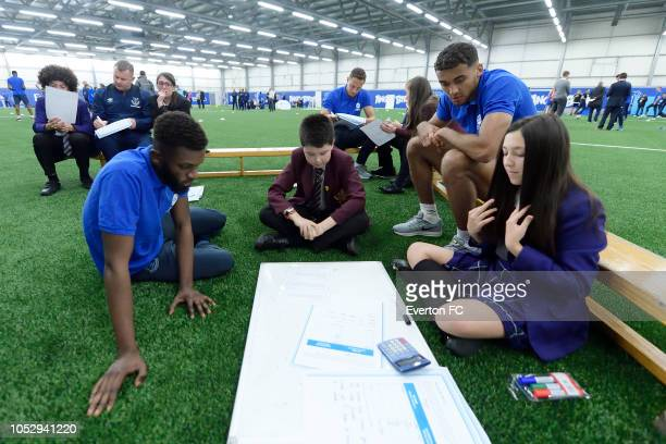Beni Baningime Dominic CalvertLewin and Phil Jagielka take part in the Everton in the Community event at USM Finch Farm on October 24 2018 in...
