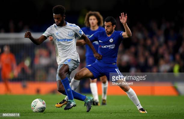 Beni Baningime of Everton and Pedro of Chelsea battle for possession during the Carabao Cup Fourth Round match between Chelsea and Everton at...