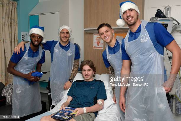 Beni Baningime Sandro Ramirez Muhamed Besic and Joel Robles during the visit of Everton players Christmas visit to Alder Hey Childrens Hospital on...