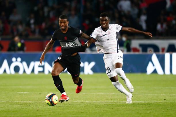 Beni Makouana of Montpellier Herault SC challenges Georginio Wijnaldum of Paris Saint-Germain during the Ligue 1 Uber Eats match between Paris Saint...