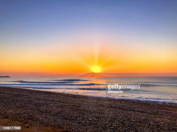 benicarló beach and sunset - romantic sunset stock pictures, royalty-free photos & images