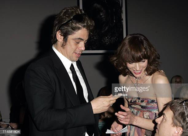Benicio Del Toro and Milla Jovovich during amfAR Cinema Against AIDS Gala Presented By Miramax Films Palisades Pictures and Quintessentially Dinner...
