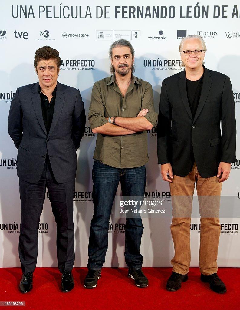 Benicio del Toro, Fernando Leon de Aranoa and Tim Robbins attend 'Un Dia Perfecto' photocall at Villamagna Hotel on August 25, 2015 in Madrid, Spain.