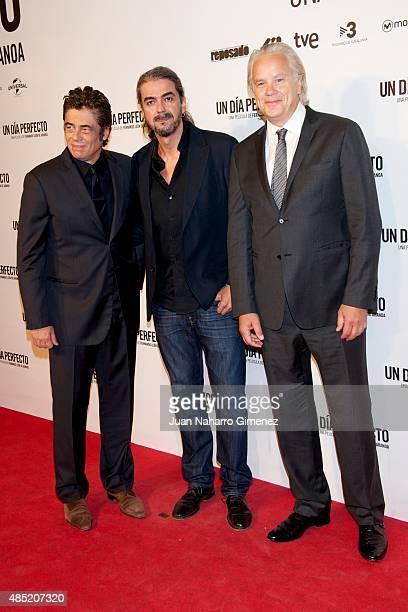 Benicio del Toro Fernando Leon de Aranoa and Tim Robbins attend 'Un Dia Perfecto' premiere at Palafox Cinema on August 25 2015 in Madrid Spain