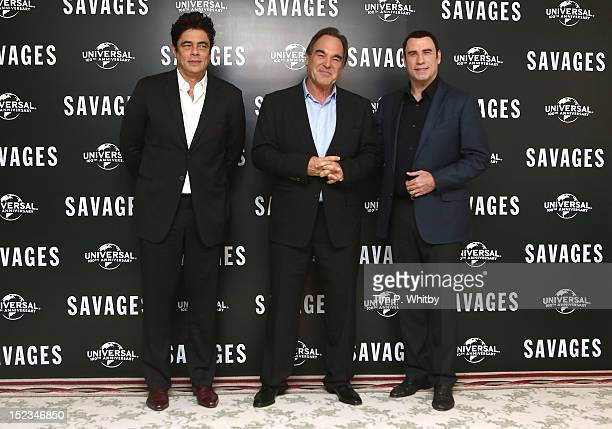 Benicio Del Toro, Oliver Stone and John Travolta attend a photocall for new film 'Savages' at The Mandarin Oriental on September 19, 2012 in London,...