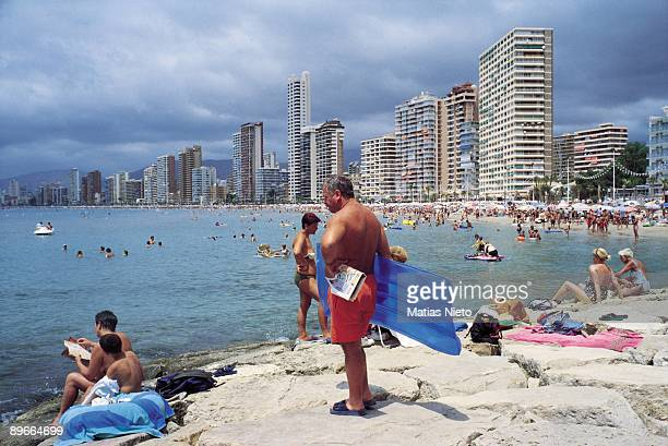Benidorm Alicante Tourists in the beach To the bottom the coastal skyscrapers of the biggest tourist center in the Mediterranean