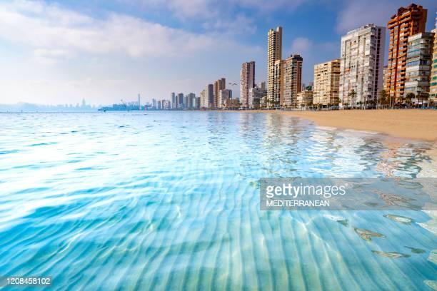 benidorm levante beach clar turquoise water in alicante spain - benidorm foto e immagini stock