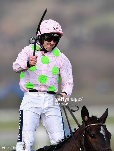 Benie Des Dieux ridden by Ruby Walsh celebrates winning the Mares' Hurdle on Champion Day of the Cheltenham Festival at Cheltenham Racecourse on...