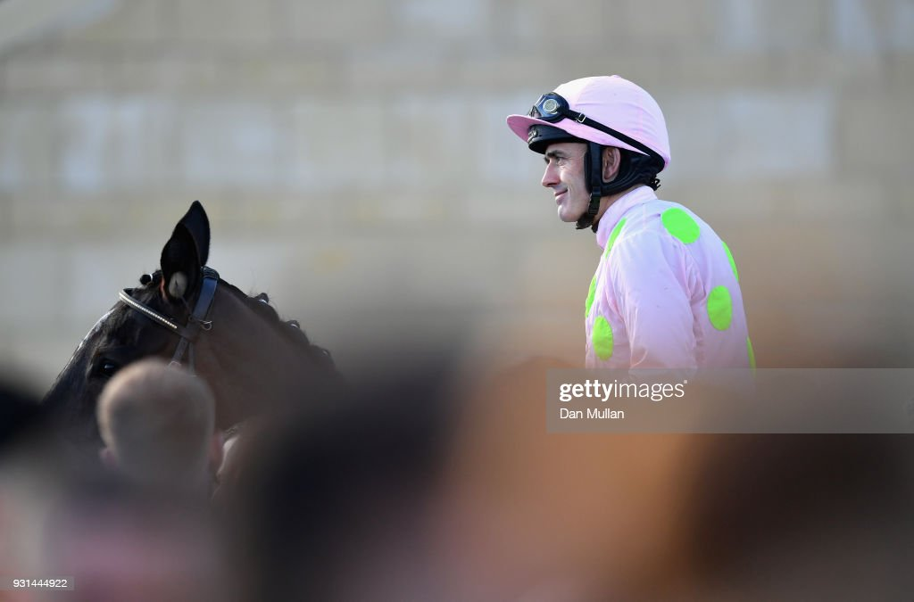 Benie Des Dieux ridden by Ruby Walsh celebrates winning the Mares' Hurdle on Champion Day of the Cheltenham Festival at Cheltenham Racecourse on March 13, 2018 in Cheltenham, England.