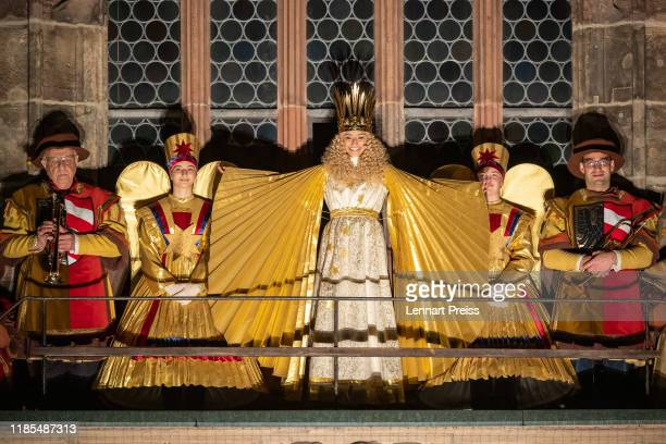 Benigna Munsi the newly elected Nuremberg Christ Child appears at the churchs balcony during the opening of the Nuremberg Christmas market on...