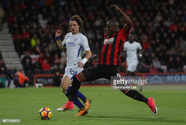 Benik Afobe of AFC Bournemouth and David Luiz of Chelsea battle for possession during the Premier League match between AFC Bournemouth and Chelsea at...