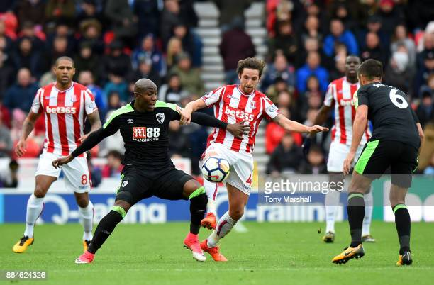 Benik Afobe of AFC Bournemouth and Joe Allen of Stoke City during the Premier League match between Stoke City and AFC Bournemouth at Bet365 Stadium...