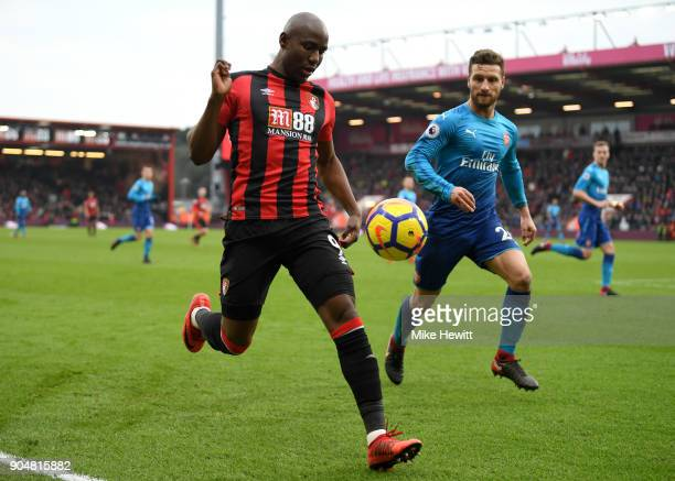 Benik Afobe of AFC Bournemouth and Shkodran Mustafi of Arsenal in action during the Premier League match between AFC Bournemouth and Arsenal at...