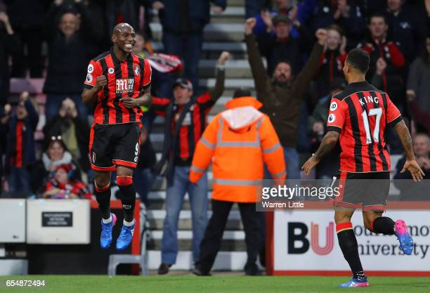 Benik Afobe of AFC Bournemouth celebrates scoring his sides first goal with Joshua King of AFC Bournemouth during the Premier League match between...