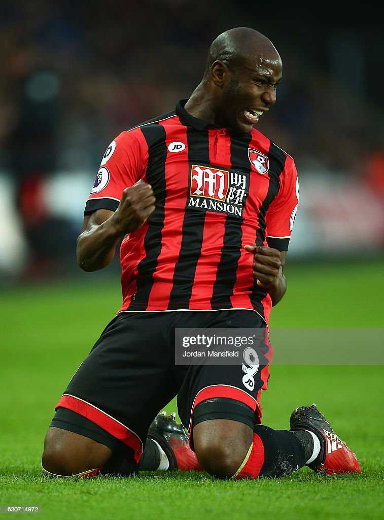 Benik Afobe of AFC Bournemouth celebrates scoring the opening goal during the Premier League match between Swansea City and AFC Bournemouth at Liberty Stadium on December 31, 2016 in Swansea, Wales.
