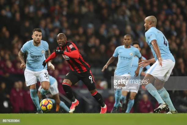 Benik Afobe of AFC Bournemouth chases down the ball during the Premier League match between Manchester City and AFC Bournemouth at Etihad Stadium on...