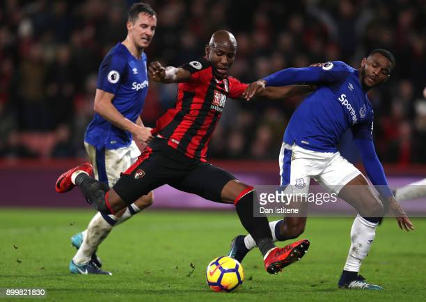Benik Afobe of AFC Bournemouth is challenged by Cuco Martina of Everton during the Premier League match between AFC Bournemouth and Everton at...