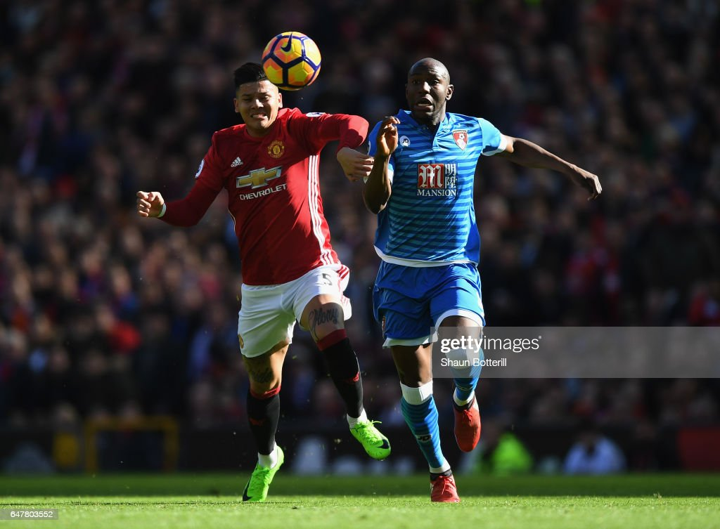 Benik Afobe Of AFC Bournemouth Is Challenged By Marcos