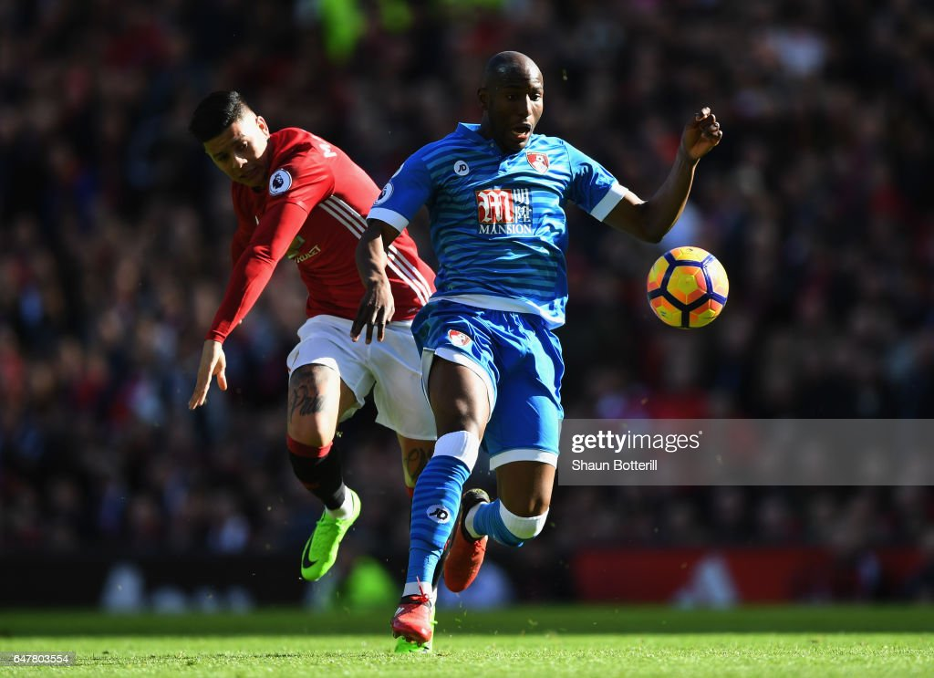 Benik Afobe of AFC Bournemouth is challenged by Marcos Rojo of Manchester United during the Premier League match between Manchester United and AFC Bournemouth at Old Trafford on March 4, 2017 in Manchester, England.