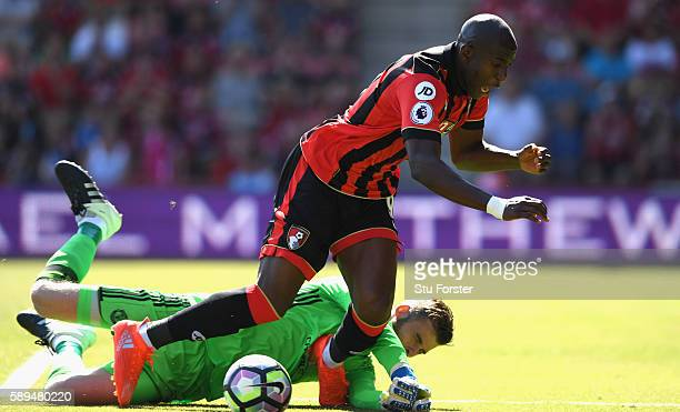 Benik Afobe of AFC Bournemouth is tackled by David De Gea of Manchester United during the Premier League match between AFC Bournemouth and Manchester...