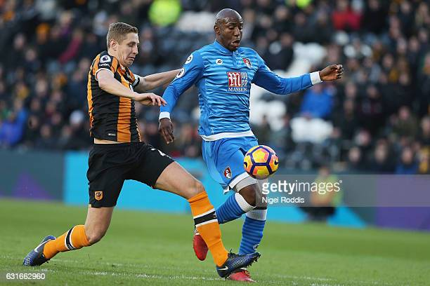 Benik Afobe of AFC Bournemouth is tackled by Michael Dawson of Hull City during the Premier League match between Hull City and AFC Bournemouth at...