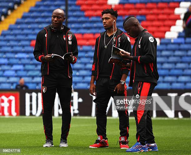 Benik Afobe of AFC Bournemouth Jordan Ibe of AFC Bournemouth and Max Gradel of AFC Bournemouth read the match day program prior to kick off during...