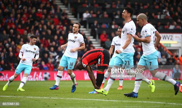 Benik Afobe of AFC Bournemouth reacts to missing his sides second penalty during the Premier League match between AFC Bournemouth and West Ham United...