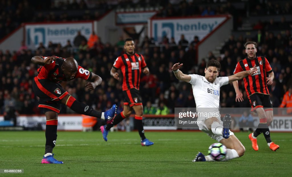 Benik Afobe of AFC Bournemouth (L) scores his sides second goal during the Premier League match between AFC Bournemouth and Swansea City at Vitality Stadium on March 18, 2017 in Bournemouth, England.