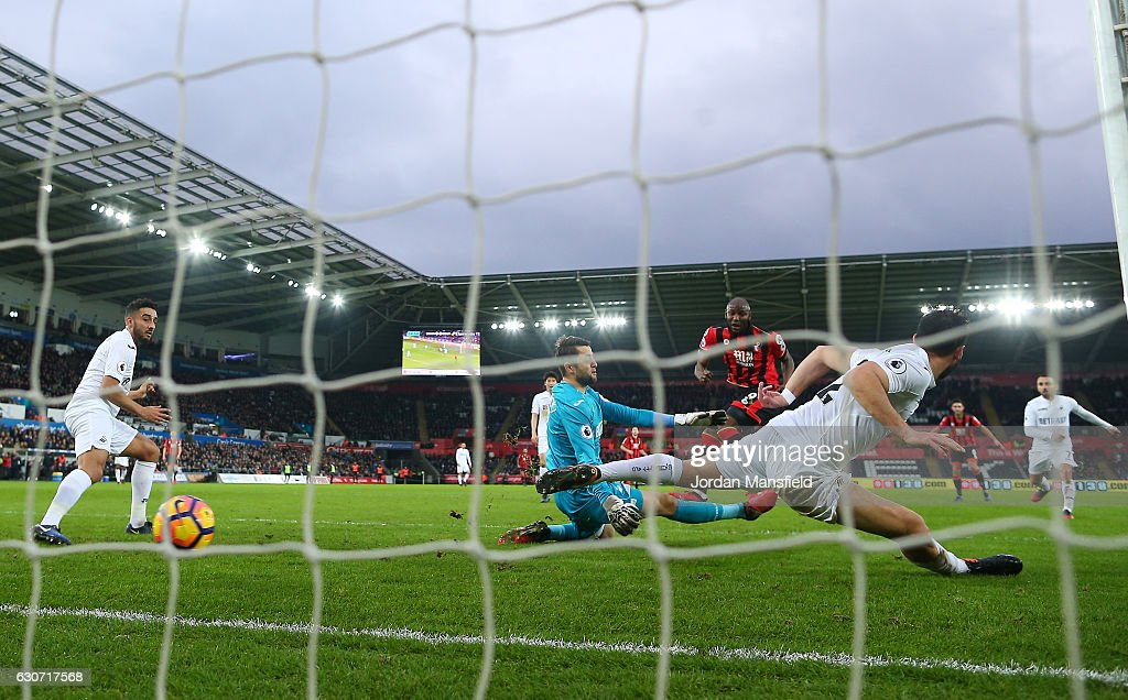 Benik Afobe of AFC Bournemouth scores the opening goal during the Premier League match between Swansea City and AFC Bournemouth at Liberty Stadium on December 31, 2016 in Swansea, Wales.