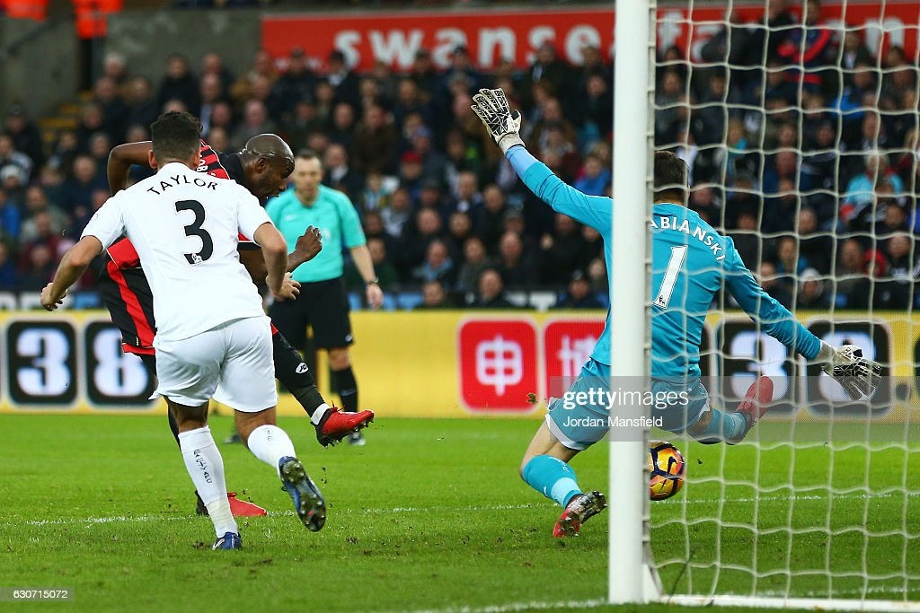 Benik Afobe of AFC Bournemouth scores the opening goal past Lukasz Fabianski of Swansea City during the Premier League match between Swansea City and AFC Bournemouth at Liberty Stadium on December 31, 2016 in Swansea, Wales.