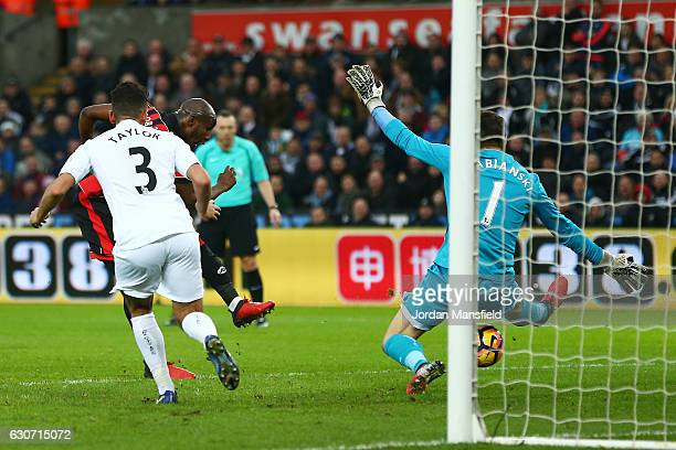 Benik Afobe of AFC Bournemouth scores the opening goal past Lukasz Fabianski of Swansea City during the Premier League match between Swansea City and...