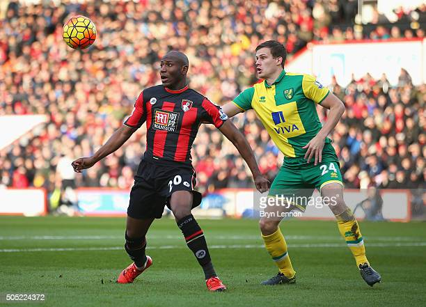 Benik Afobe of Bournemouth and Ryan Bennett of Norwich City compete for the ball during the Barclays Premier League match between AFC Bournemouth and...