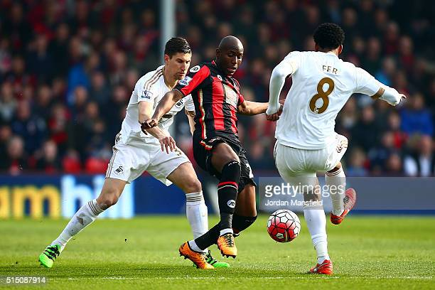 Benik Afobe of Bournemouth controls the ball under pressure of Federico Fernandez and Leroy Fer of Swansea City during the Barclays Premier League...