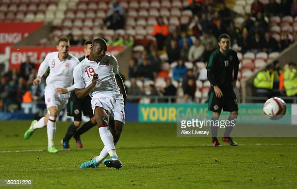 Benik Afobe of England U21 scores the second goal from the penalty spot during the International Friendly Match between England U21 and Northern...