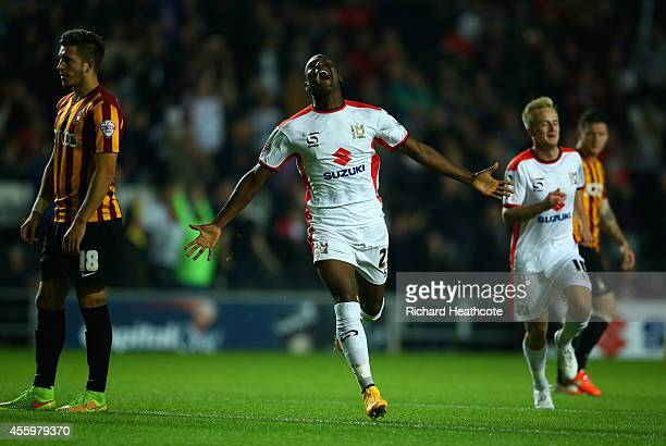 Benik Afobe of MK Dons scores the first goal during the Capital One Cup Third Round match between MK Dons and Bradford City at Stadium mk on...