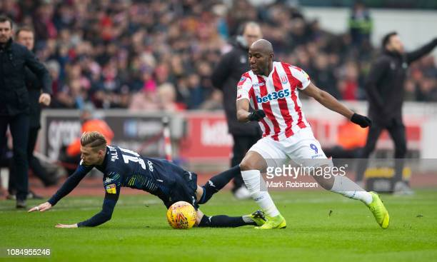 Benik Afobe of Stoke City and Ezgjan Alioski of Leeds United compete for the ball during the Sky Bet Championship match between Stoke City and Leeds...