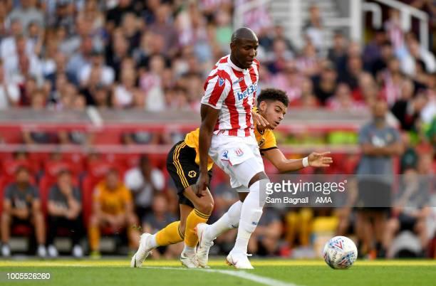 Benik Afobe of Stoke City and Morgan GibbsWhite of Wolverhampton Wanderers during the PreSeason Friendly match between Stoke City v Wolverhampton...