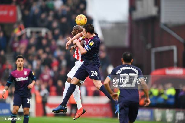 Benik Afobe of Stoke City battles with Tommy Elphick of Aston Villa during the Sky Bet Championship match between Stoke City and Aston Villa at the...