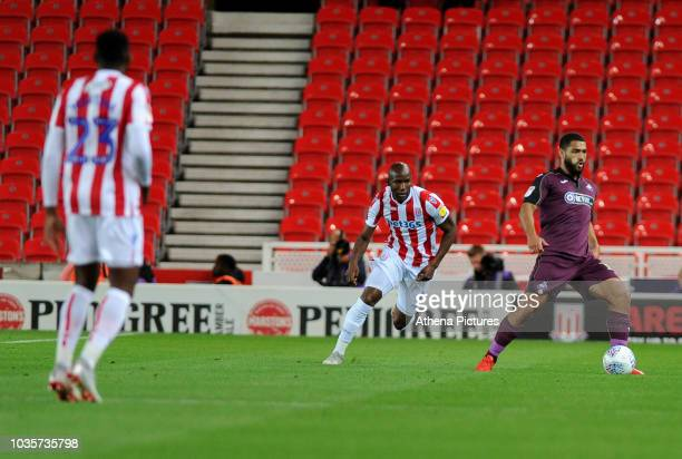 Benik Afobe of Stoke City vies for possession with Cameron CarterVickers of Swansea City during the Sky Bet Championship match between Stoke City and...