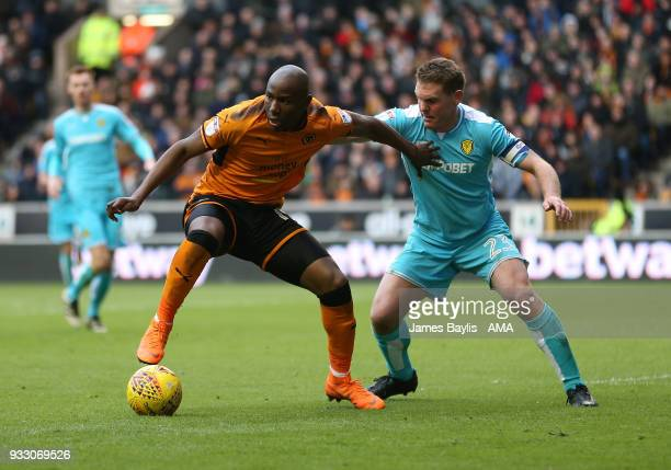 Benik Afobe of Wolverhampton Wanderers and Jake Buxton of Burton Albion during the Sky Bet Championship match between Wolverhampton Wanderers and...