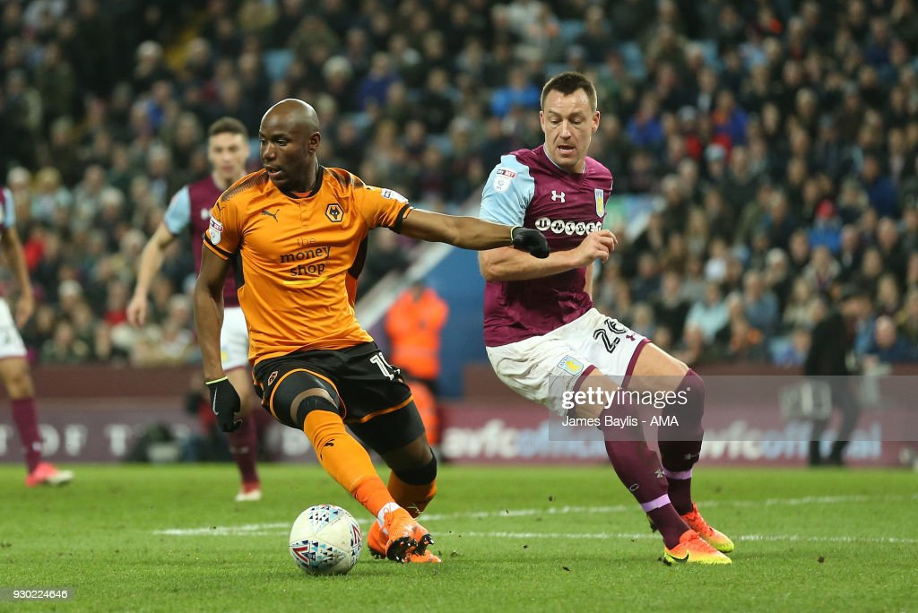 Benik Afobe of Wolverhampton Wanderers and John Terry of Aston Villa during the Sky Bet Championship match between Aston Villa and Wolverhampton Wanderers at Villa Park on March 10, 2018 in Birmingham, England.