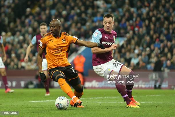Benik Afobe of Wolverhampton Wanderers and John Terry of Aston Villa during the Sky Bet Championship match between Aston Villa and Wolverhampton...